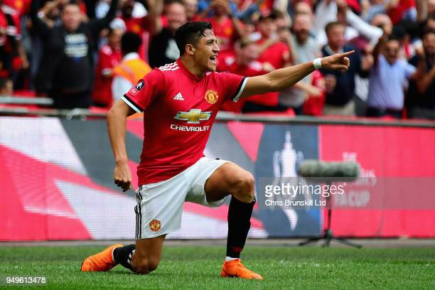 Alexis Sanchez of Manchester United celebrates after scoring his sides first goal during The Emirates FA Cup Semi Final match between Manchester...