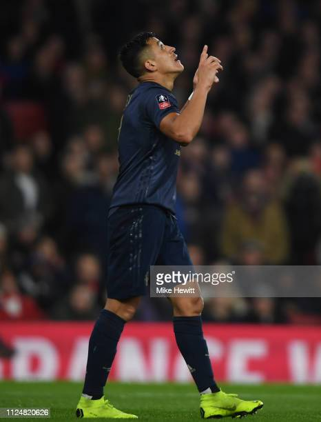 Alexis Sanchez of Manchester United celebrates as he scores his team's first goal during the FA Cup Fourth Round match between Arsenal and Manchester...