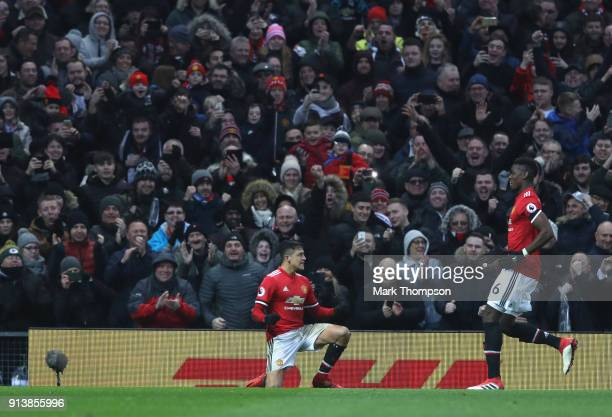Alexis Sanchez of Manchester United celebrates his goal with team mate Paul Pogba during the Premier League match between Manchester United and...