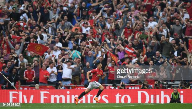 Alexis Sanchez of Manchester United celebrates infront of his fans after scoring his sides first goal during The Emirates FA Cup Semi Final match...