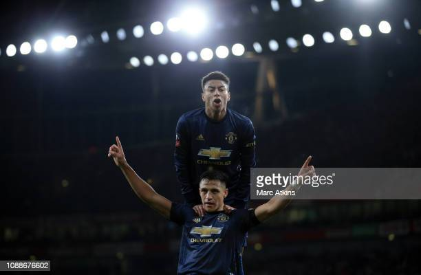 Alexis Sanchez of Manchester United celebrates scoring the opening goal with Jesse Lingard during the FA Cup Fourth Round match between Arsenal and...