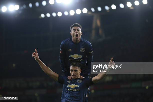 Alexis Sanchez of Manchester United celebrates scoring their 1st goal with Jesse Lingard during the FA Cup Fourth Round match between Arsenal and...