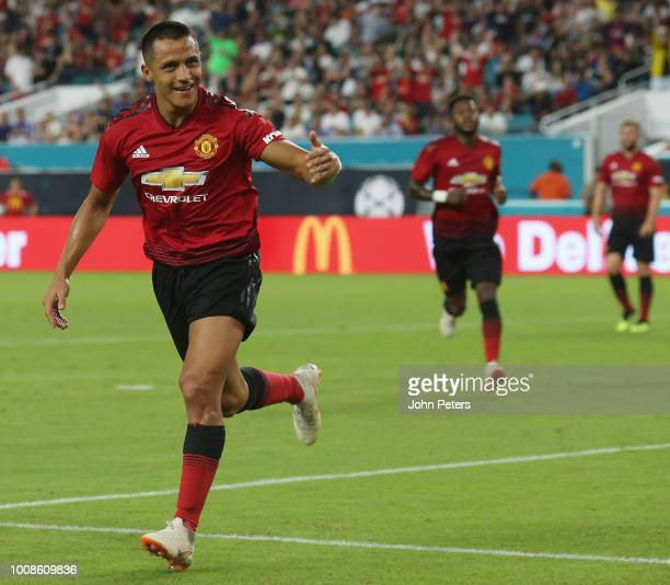Alexis Sanchez of Manchester United celebrates scoring their first goal during the preseason friendly match between Manchester United and Real Madrid...