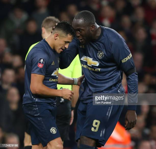 Alexis Sanchez of Manchester United celebrates scoring their first goal during the FA Cup Fourth Round match between Arsenal and Manchester United at...