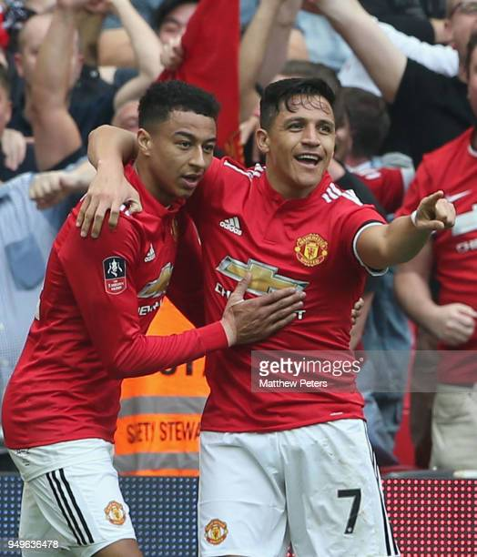 Alexis Sanchez of Manchester United celebrates scoring their first goal during the Emirates FA Cup semifinal match between Manchester United and...