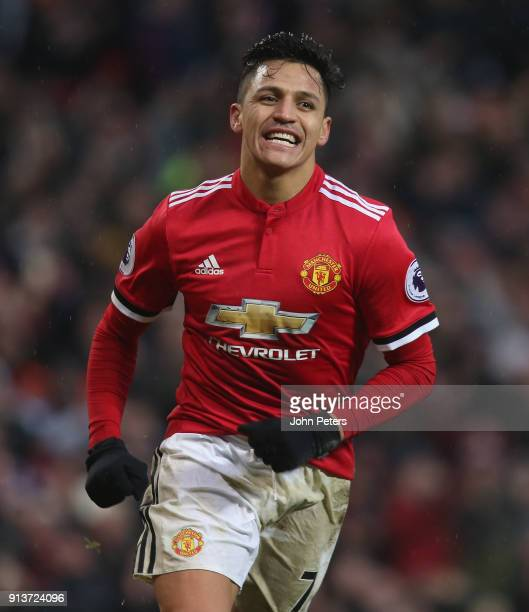 Alexis Sanchez of Manchester United celebrates scoring their second goal during the Premier League match between Manchester United and Huddersfield...