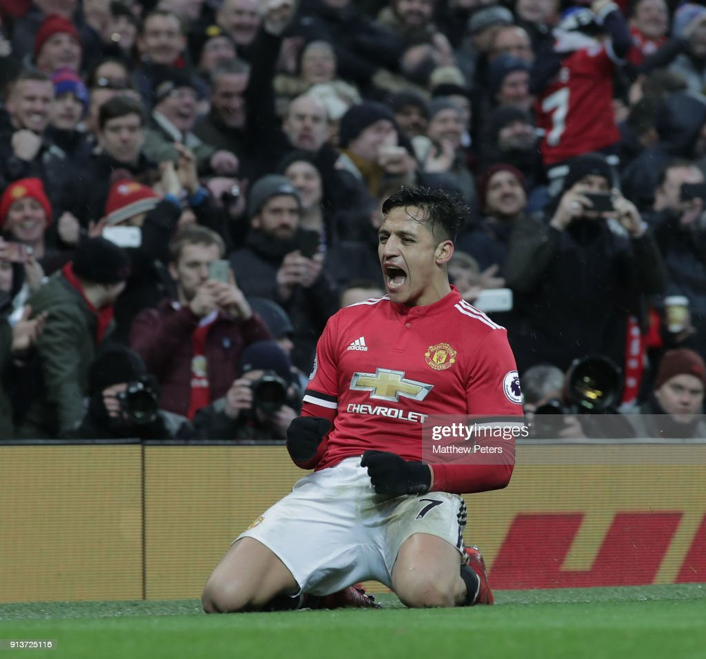 Alexis Sanchez of Manchester United celebrates scoring their second goalduring the Premier League match between Manchester United and Huddersfield Town at Old Trafford on February 3, 2018 in Manchester, England.
