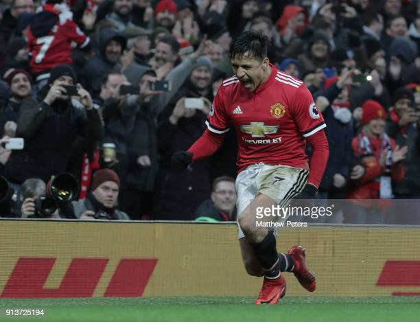Alexis Sanchez of Manchester United celebrates scoring their second goalduring the Premier League match between Manchester United and Huddersfield...