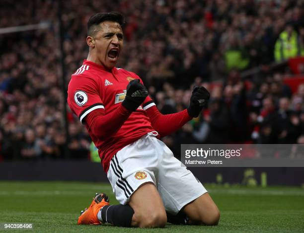Alexis Sanchez of Manchester United celebrates scoring their second goal during the Premier League match between Manchester United and Swansea City...