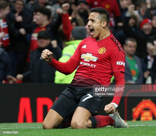Alexis Sanchez of Manchester United celebrates scoring their third goal during the Premier League match between Manchester United and Newcastle...