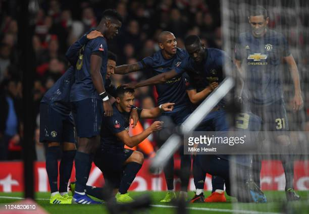 Alexis Sanchez of Manchester United celebrates with team mates as he scores his team's first goal during the FA Cup Fourth Round match between...