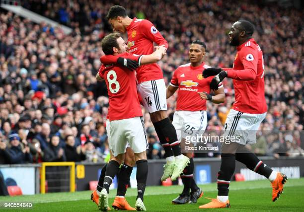 Alexis Sanchez of Manchester United celebrates with teammates after scoring his sides second goal during the Premier League match between Manchester...