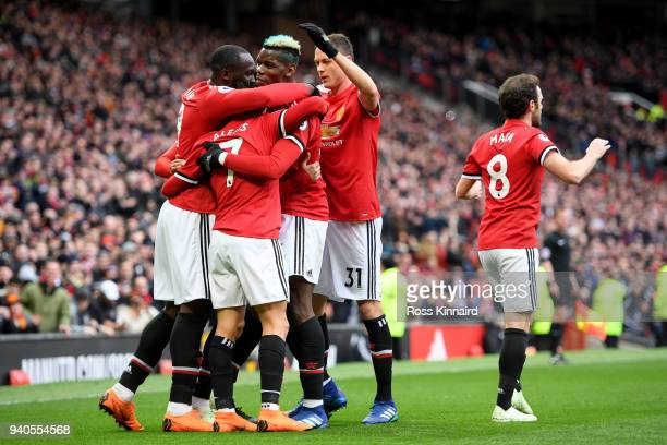 Alexis Sanchez of Manchester United celebrates with teammates during the Premier League match between Manchester United and Swansea City at Old...