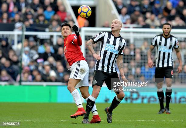 Alexis Sanchez of Manchester United competes for the ball with Jonjo Shelvey of Newcastle United during the Premier League match between Newcastle...