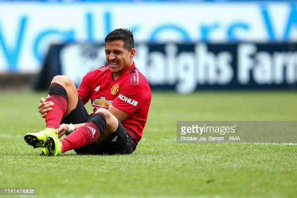 Alexis Sanchez of Manchester United down injured during the Premier League match between Huddersfield Town and Manchester United at John Smith's...