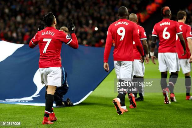 Alexis Sanchez of Manchester United follows his team mates out onto the pitch before the Premier League match between Tottenham Hotspur and...