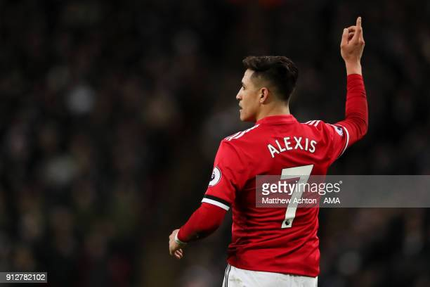 Alexis Sanchez of Manchester United gestures during the Premier League match between Tottenham Hotspur and Manchester United at Wembley Stadium on...