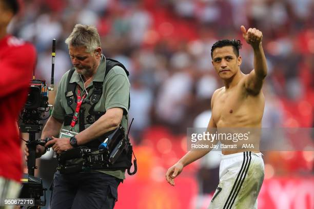 Alexis Sanchez of Manchester United gives the fans a thumbs up during The Emirates FA Cup Semi Final match between Manchester United and Tottenham...