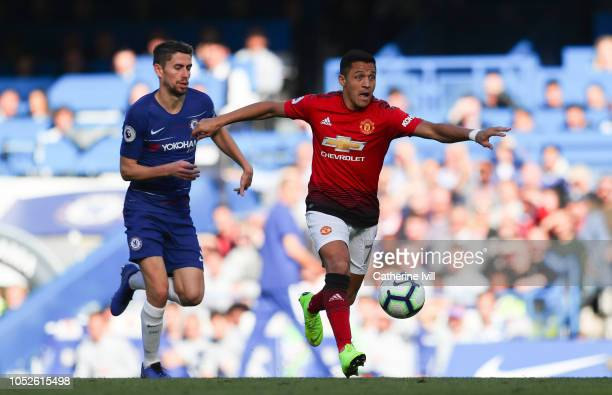 Alexis Sanchez of Manchester United holds off Jorginho of Chelsea during the Premier League match between Chelsea FC and Manchester United at...