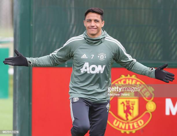 Alexis Sanchez of Manchester United in action during a first team training session at Aon Training Complex on April 28 2018 in Manchester England