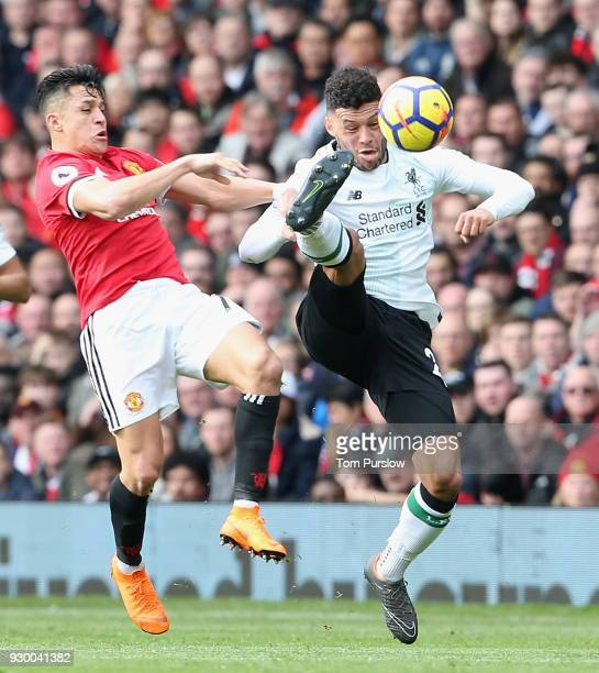 Alexis Sanchez of Manchester United in action with Alex OxladeChamberlain of Liverpool during the Premier League match between Manchester United and...