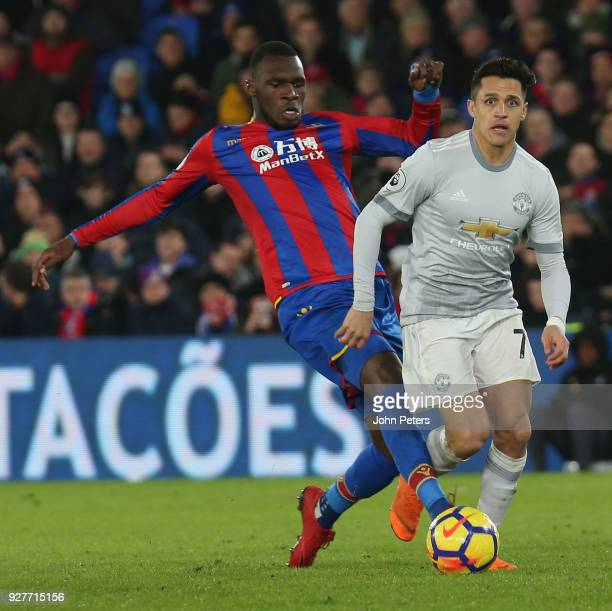 Alexis Sanchez of Manchester United in action with Christian Benteke of Crystal Palace during the Premier League match between Crystal Palace and...