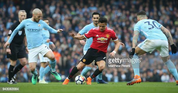 Alexis Sanchez of Manchester United in action with David Silva and Nicolas Otamendi of Manchester City during the Premier League match between...
