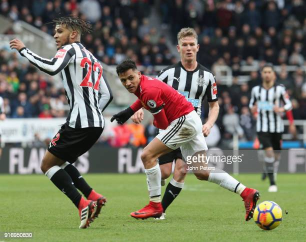 Alexis Sanchez of Manchester United in action with Deandre Yedlin of Newcastle United during the Premier League match between Newcastle United and...