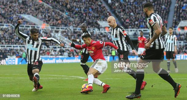 Alexis Sanchez of Manchester United in action with Deandre Yedlin, Mohamed Diame, Jonjo Shelvey and Jamaal Lascelles of Newcastle United during the...
