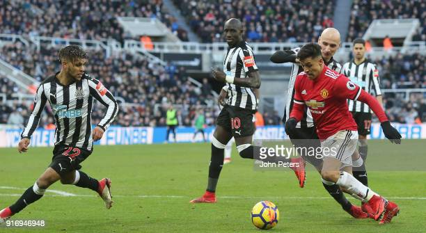 Alexis Sanchez of Manchester United in action with Deandre Yedlin Mohamed Diame Jonjo Shelvey and Jamaal Lascelles of Newcastle United during the...