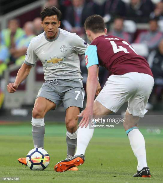 Alexis Sanchez of Manchester United in action with Declan Rice of West Ham United during the Premier League match between West Ham United and...