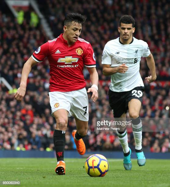 Alexis Sanchez of Manchester United in action with Dominic Solanke of Liverpool during the Premier League match between Manchester United and...