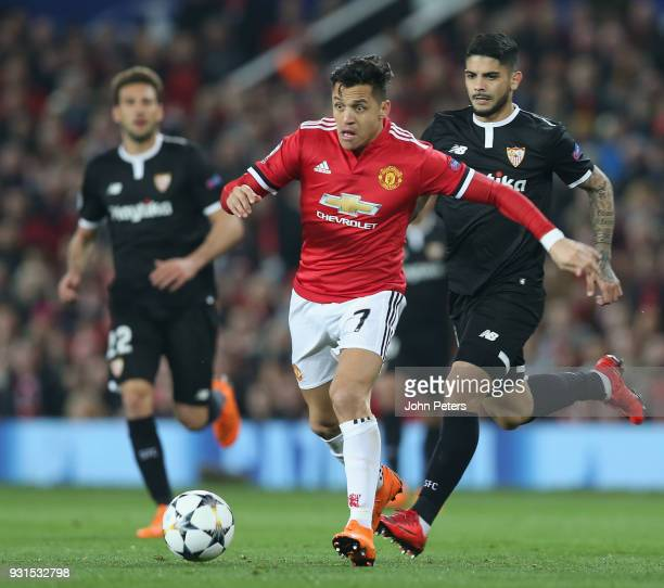 Alexis Sanchez of Manchester United in action with Ever Banega of Sevilla FC during the UEFA Champions League Round of 16 Second Leg match between...