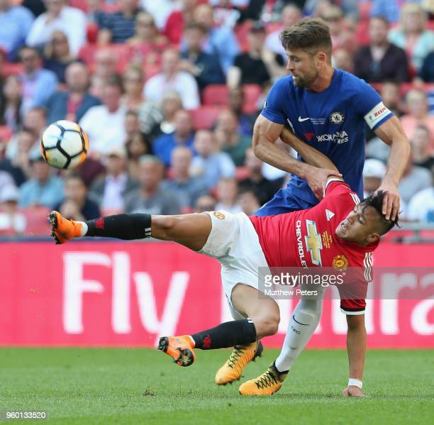 Alexis Sanchez of Manchester United in action with Gary Cahill of Chelsea during the Emirates FA Cup Final match between Manchester United and...