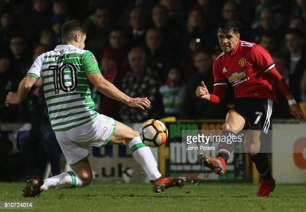 Alexis Sanchez of Manchester United in action with Jake Gray of Yeovil Town during the Emirates FA Cup Fourth Round match between Yeovil Town and...