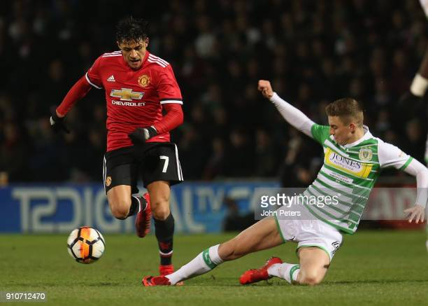 Alexis Sanchez of Manchester United in action with Jared Bird of Yeovil Town during the Emirates FA Cup Fourth Round match between Yeovil Town and...