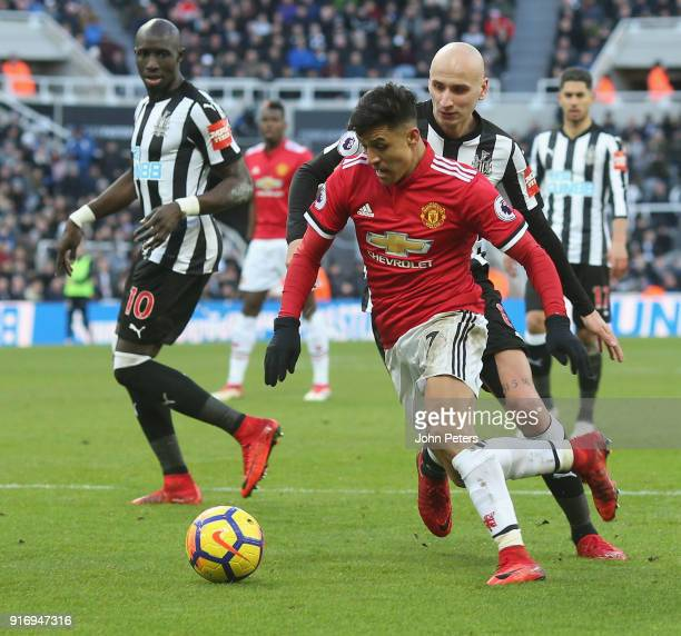 Alexis Sanchez of Manchester United in action with Jonjo Shelvey of Newcastle United during the Premier League match between Newcastle United and...