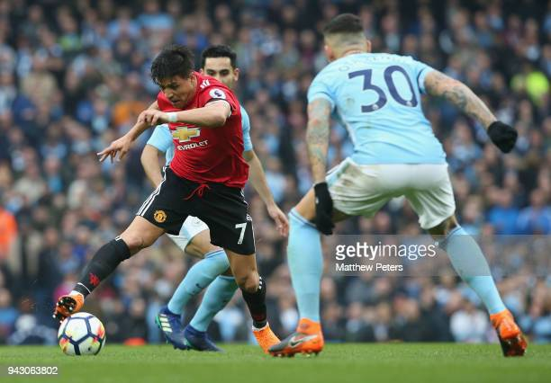 Alexis Sanchez of Manchester United in action with Nicolas Otamendi of Manchester City during the Premier League match between Manchester City and...