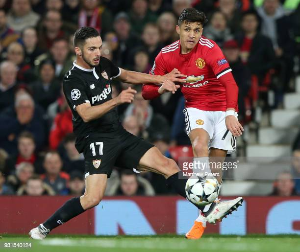 Alexis Sanchez of Manchester United in action with Pablo Sarabia of Sevilla FC during the UEFA Champions League Round of 16 Second Leg match between...
