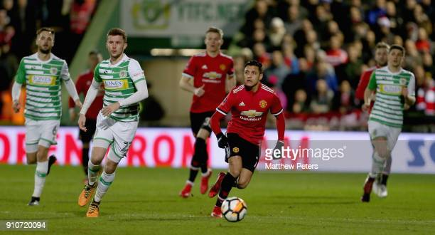 Alexis Sanchez of Manchester United in action with Tom James of Yeovil Town during the Emirates FA Cup Fourth Round match between Yeovil Town and...