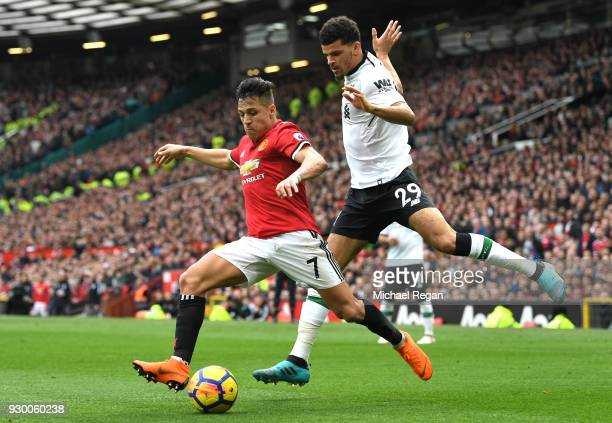 Alexis Sanchez of Manchester United is challenged by Dominic Solanke of Liverpool during the Premier League match between Manchester United and...