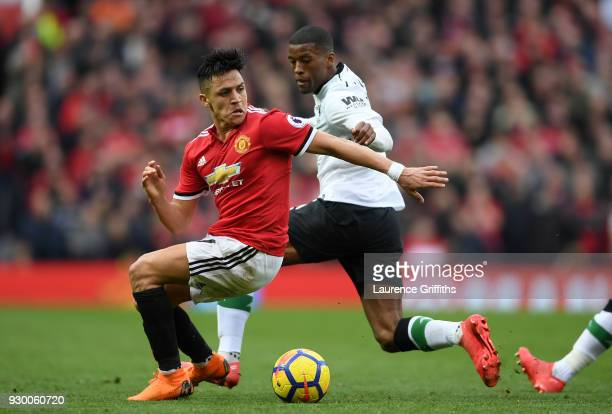 Alexis Sanchez of Manchester United is challenged by Georginio Wijnaldum of Liverpool during the Premier League match between Manchester United and...