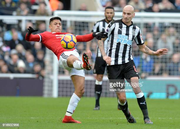 Alexis Sanchez of Manchester United is challenged by Jonjo Shelvey of Newcastle United during the Premier League match between Newcastle United and...