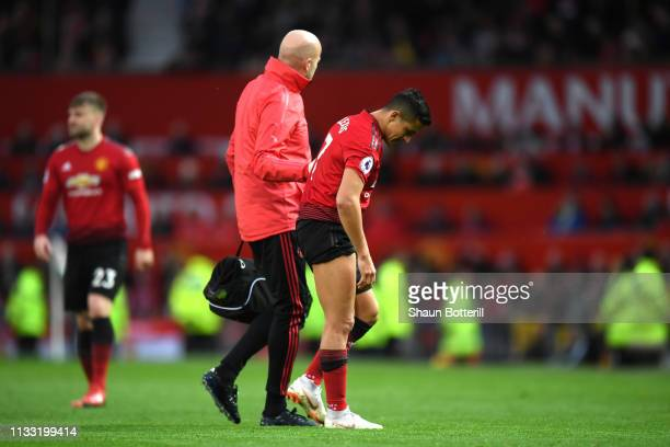 Alexis Sanchez of Manchester United is forced to leave the pitch with an injury during the Premier League match between Manchester United and...