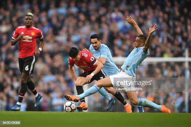 Alexis Sanchez of Manchester United is fouled by Danilo of Manchester City during the Premier League match between Manchester City and Manchester...