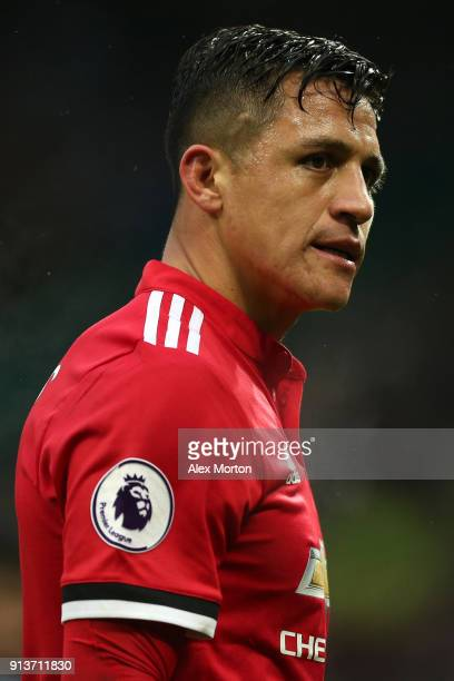 Alexis Sanchez of Manchester United leaves the pitch at half time during the Premier League match between Manchester United and Huddersfield Town at...