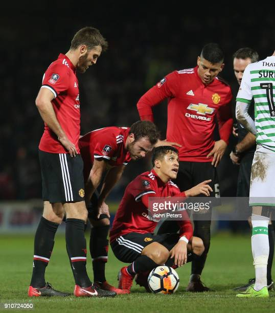 Alexis Sanchez of Manchester United lies injured during the Emirates FA Cup Fourth Round match between Yeovil Town and Manchester United at Huish...