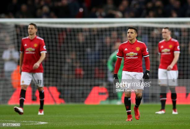 Alexis Sanchez of Manchester United look dejected after Tottenham Hotspur first goal during the Premier League match between Tottenham Hotspur and...