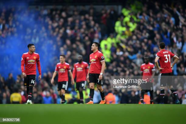 Alexis Sanchez of Manchester United looks dejected after his side conceede during the Premier League match between Manchester City and Manchester...