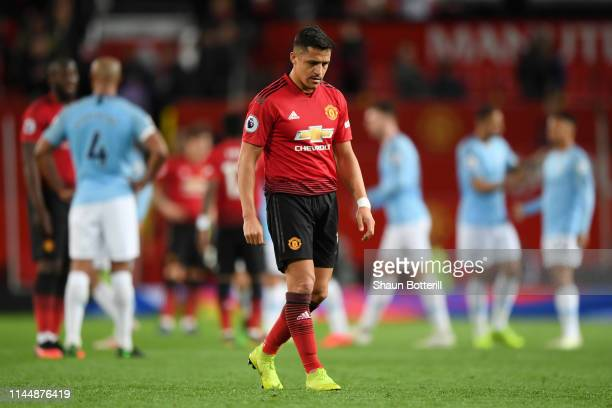 Alexis Sanchez of Manchester United looks dejected after the Premier League match between Manchester United and Manchester City at Old Trafford on...